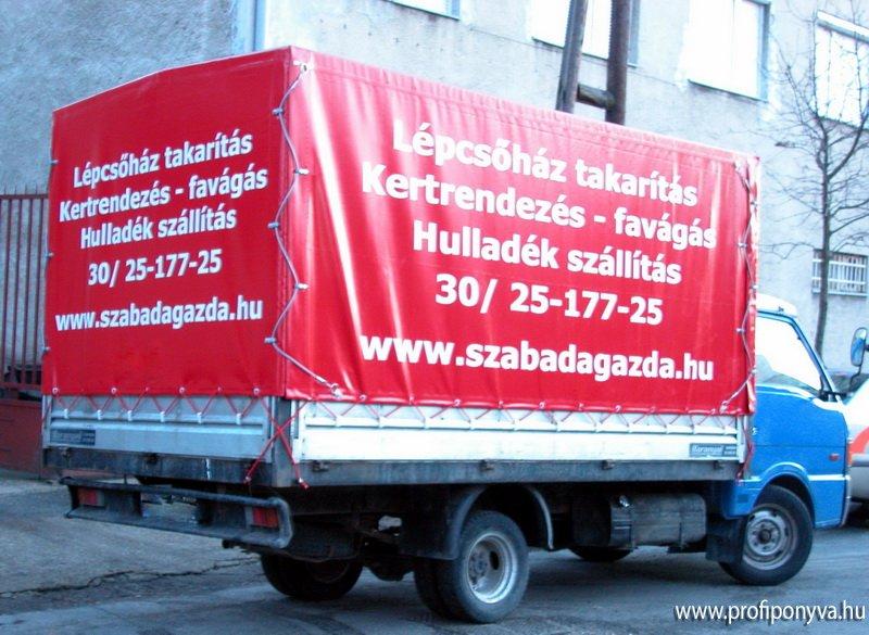 Piros feliratos teherautó ponyva